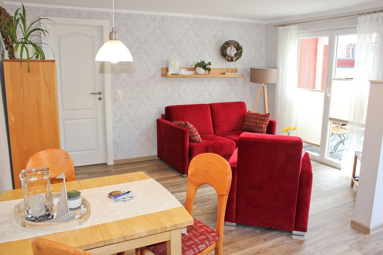 """Wohnzimmer der Ferienwohnung """"Austernfischer"""" im Zentrum von Büsum an der Nordsee"""